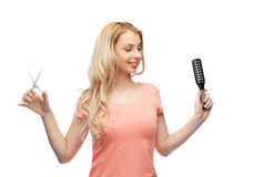 Young woman with scissors and hairbrush Royalty Free Stock Images