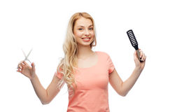 Young woman with scissors and hairbrush Royalty Free Stock Photos