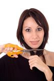 Young woman and scissors, isolated Royalty Free Stock Photography