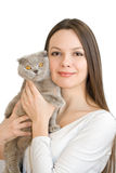 Young woman with scottish-fold cat stock images