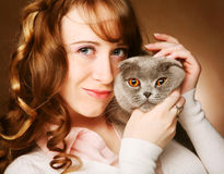 Young woman with scottish-fold cat Stock Image