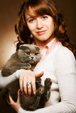 Young woman with scottish-fold cat Stock Photography