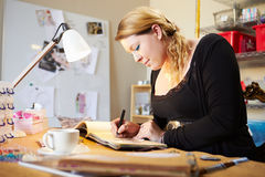 Young Woman Scrapbooking At Home Royalty Free Stock Photos