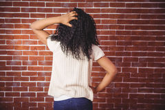 Young woman scratching her head Royalty Free Stock Image