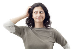 Young woman scratching her head Royalty Free Stock Photography