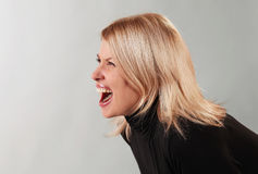 Young woman screaming Stock Image