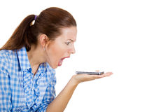 A young woman screaming angrily on the mobile phone Stock Photos