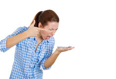 Young woman screaming  angrily on the phone Stock Images