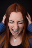 Young woman screaming at black background. Royalty Free Stock Photo