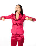 Young woman screaming and clenching fists over white. Background Royalty Free Stock Photography