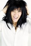 Young woman screaming desperate about messy hair Stock Image