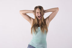 Young woman screaming. Excited young woman screaming against white background Royalty Free Stock Photography