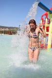 Young woman screaming with excitement in aqua park Stock Photo