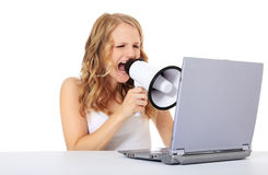 Young woman screaming at laptop Stock Photography