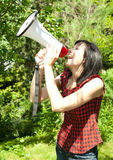 Young woman screaming with a megaphone Royalty Free Stock Images