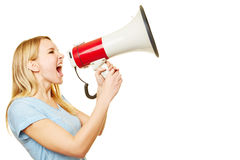 Young woman screaming into megaphone Royalty Free Stock Images