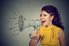 Young woman screaming in megaphone Stock Photography