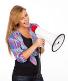 Young woman screaming with megaphone Royalty Free Stock Photography