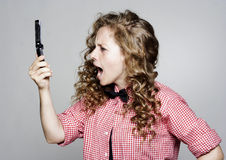 Young woman screaming on the phone Stock Photography