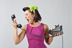 Young woman screaming into a phone . Royalty Free Stock Photo