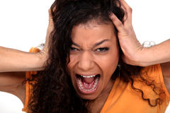 Young woman screaming. Portrait of a young woman screaming Royalty Free Stock Image
