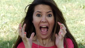 Young woman screaming in surprise