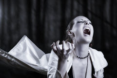Young woman screaming  - vampire style Royalty Free Stock Images