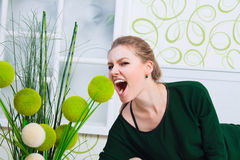 Young woman screaming in the white-green room. Young woman in the white-green room stock image