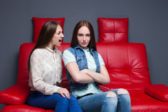 Young woman screams on her girlfriend Stock Photos