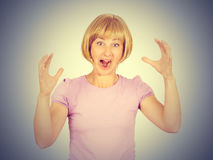 Young woman screams in terror, faces portrait. Stock Image