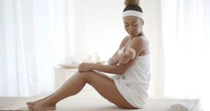 Young Woman Scrubbing Her Leg Stock Image
