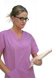 Young Woman in Scrubs. Holding a file, isolated on white background Stock Image