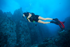 Young woman scuba diver exploring sea bottom Stock Image