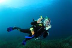 Young woman scuba diving stock photo