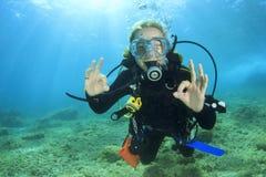 Young woman scuba diving royalty free stock photos