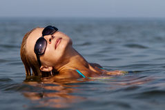 Young woman in sea Stock Photo