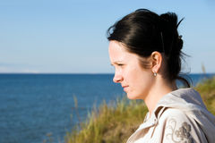 Young woman at sea. Portrait of young woman at sea shore royalty free stock photos
