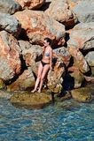 Young woman by the sea, Agios Nikolaos. Royalty Free Stock Images