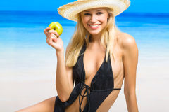 Young woman on sea beach Royalty Free Stock Images