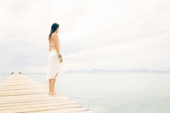Young Woman By The Sea Royalty Free Stock Photos