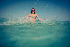 Young woman in the sea Stock Images