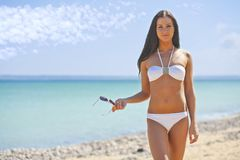 Woman on the sea in a white bikini Royalty Free Stock Images