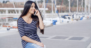 Young woman on a seafront promenade Stock Photos