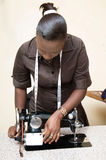 Young woman seamstress. This young woman is now well placed the engine of her sewing machine Stock Photo