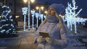 Young woman searches a street on winter night background stock footage
