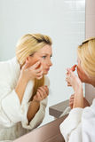 Young Woman Searching For Wrinkles On Her Face Royalty Free Stock Photo