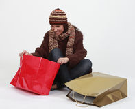 Young woman searching for gifts Royalty Free Stock Images