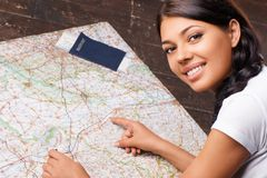 Young woman searching a map Royalty Free Stock Images