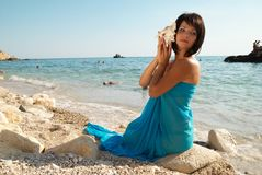 Young woman with seashell Stock Images