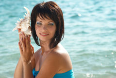 Young woman with seashell Stock Photography